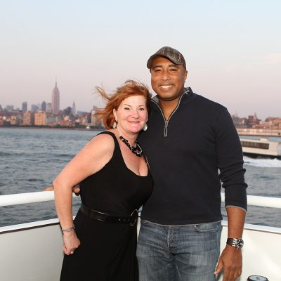 Yankee Bernie Williams posing with female on boat cruise in ny
